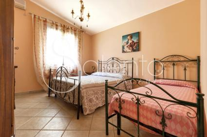 Triple bedroom with double bed and single bed