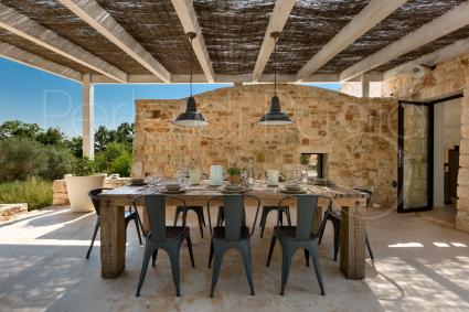 The outdoor dining area at the back of the charming villa