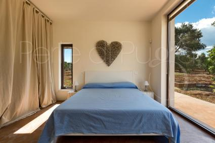 The first bedroom of the villa for rent in Puglia