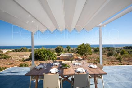 The beautiful shaded veranda where you can relax overlooking the sea