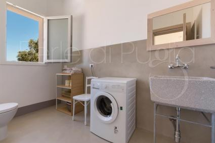A useful laundry bathroom is equipped with a washing machine