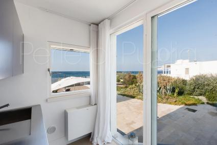 glass walls and view on the beach
