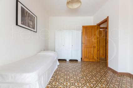 La camera singola ha un accesso diretto alla terrazza