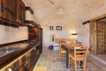 Living room and open kitchen in the first trullo