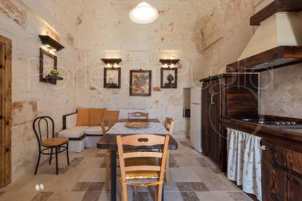 Kitchen and sofa bed in the second trullo