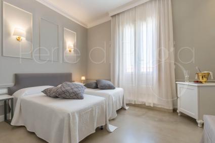 La camera con due letti matrimoniali in bed&breakfast nel Salento