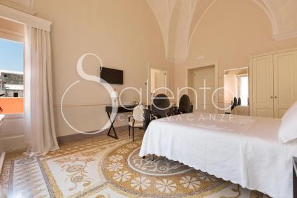 La family room del B&b Palazzo Fasti a Casarano, composta da una matrimoniale e una tripla