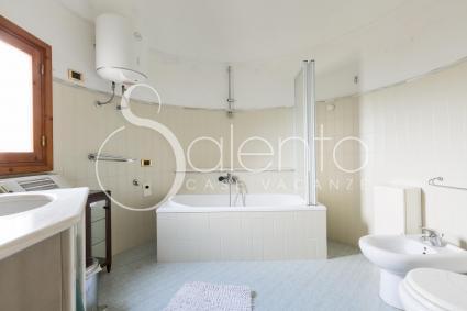 The third bathroom with a bathtub