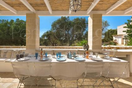 The outdoor area is shaded and equipped for lunches and dinners