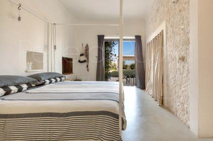 the master bedroom of the casale con cipresso