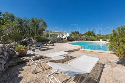 The solarium by the pool in the complex ideal for a vacation in Apulia