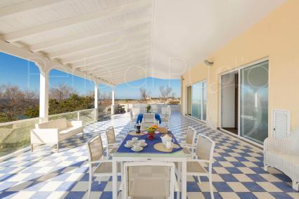 The large veranda furnished for al outdoor lunches and dinners, overlooking the sea