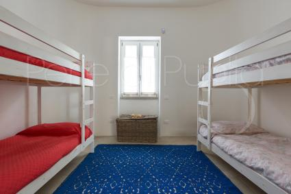 Four-bed room with bunk beds
