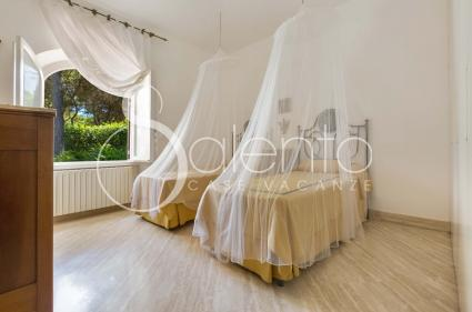 Twin bedroom with ceiling mosquito nets