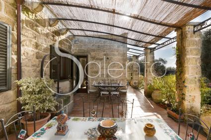 La veranda attrezzata con vista sul giardino