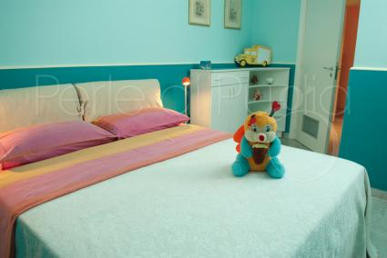 Light blue double bedroom