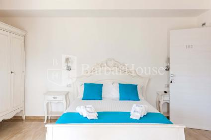 Suite Deluxe Matrimoniale 102 -With air conditioning, a TV, a fridge and a safe