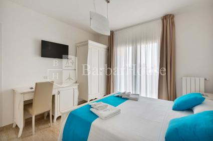 Suite Matrimoniale 105 -The room for rent in Porto Cesareo is equipped with a TV and wi-fi.