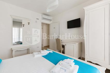 Suite Matrimoniale 105 -There is also a safe, a fridge and a veranda.
