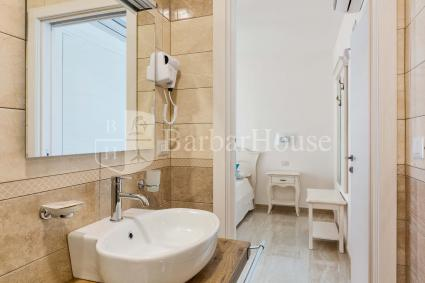 Suite Matrimoniale 105 -the room has an en suite bathroom with shower.