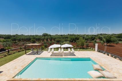 The villa is surrounded by the olive trees of the Itria Valley