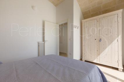 Quarta camera con bagno coddia en suite e uscita diretta in giardino