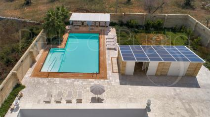 The beautiful pool and solarium seen by the drone