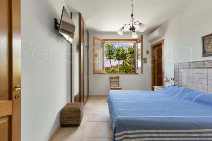 Double bedroom with air conditioning, television and ensuite bathroom with shower