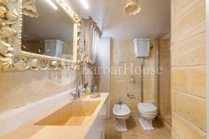 Bagno doccia en suite nella camera 1