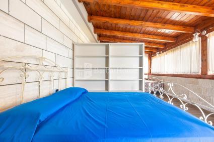 Camera quadrupla in veranda coperta